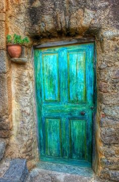 Corsica, France. The door itself is ordinary, there's something about the colors that make this simple door...well... Beautiful.