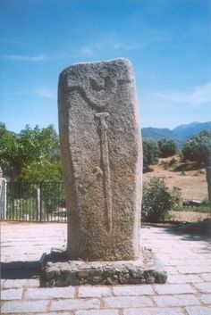 anthropomorphic menhir at Filitosa, Corsica, France, bears permanent sword representing the meeting of Bronze Age and megalithic tradition (ca. 1000 BC)