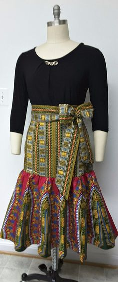 African Print Fitted Hip Midi Skirt. Sash Waistband. Womens Clothing. Handmade Clothing. African Print Skirt. This skirt is fitted at the hip, attached to a fully gathered bottom, and fully lined. The finished length of Skirt is 28 inches. Ankara   Dutch wax   Kente   Kitenge   Dashiki   African print dress   African fashion   African women dresses   African prints   Nigerian style   Ghanaian fashion   Senegal fashion   Kenya fashion   Nigerian fashion   Ankara crop top (affiliate)