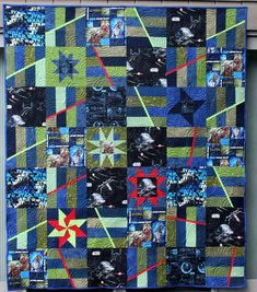 I finished Patrick's new Star Wars quilt. Remember this....?            And then I bought the fabric to make a new Star Wars quilt, 16 ye...