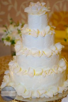 wedding cake with rose petals