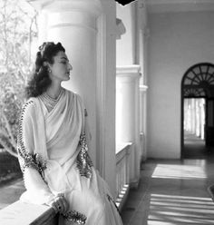 Princess Durru Shehvar Berar, only daughter of the former Sultan of Turkey, photographed wearing a jeweled sari in India.