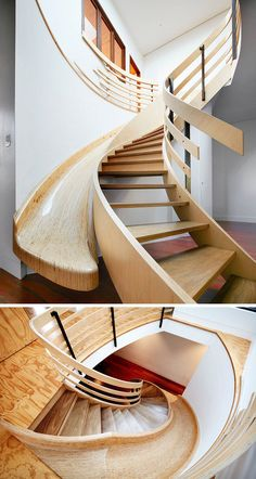 This curved wood staircase has a slide built-in right next to it to give you the option of taking the stairs or the slide when you descend to the main floor.
