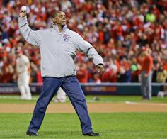 Former St. Louis Cardinals' Willie McGee throws out the ceremonial first pitch. Game 3 of the 2013 WS  10-26-13