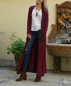Dark Burgundy Pocket-Accent Longline Open Cardigan.  Add dimension and warmth to your ensembles with this sweeping duster-style long cardigan. A pair of pockets help to keep your fingers toasty. 55% rayon / 40% polyester / 5% spandex Knit Machine wash Imported