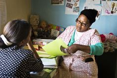 Educational Fieldworker Wendy chats with the teacher at St. Raph's creche, while she does her prep.