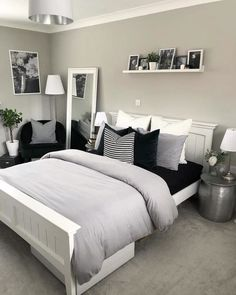 Luxury grey bedroom inspiration, grey and white modern bedroom with picture shelf styling and bedside tables, a reading corner and pillar candlesticks. White Bedroom Design, White Bedroom Decor, Room Ideas Bedroom, Home Decor Bedroom, Bedroom Chair, Bedroom Designs, White Decor, Grey Bedroom Furniture, Grey Home Decor