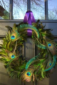 Iridescent peacock feathers add a sophisticated shimmer to this fanciful wreath, instructions courtesy of HGTV.com.