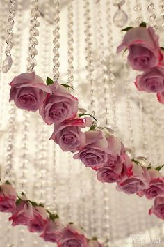 Pretty pink wedding roses hanging by crystals -  Photo: Jonetsu Studios via WedLuxe