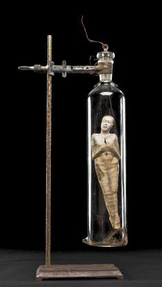 I'll bet your dad has a bunch of these in his stash... maybe there's a way you could put the puppet head on the top of a test tube and then put some found objects, old keys and rocks and such into the tube.  And then use a tube holder to display?