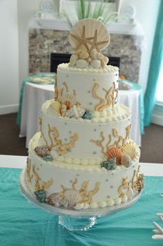 Where do you start to plan a beach themed wedding? With a beach wedding cake!
