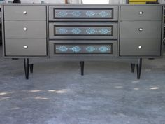 Refurbished dresser with stenciled drawers.