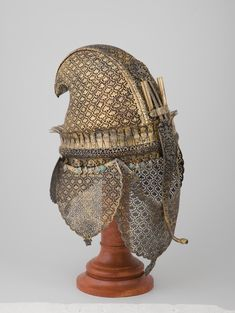 ...Helmet Place of creation: South-Western India Date: Late 17th century School: Maharashtra Material: iron Technique: forged, carved and gilded Dimension: h. 32 cm