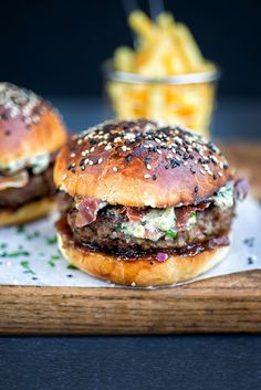 The ultimate juicy beef burger server with crispy pancetta easy blue cheese sauce onion chutney and homemade brioche buns