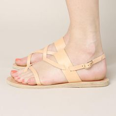 The Ancient Greek Althea Sandal is a handmade leather sandal. It features an adjustable strap with buckle closure. - Materials: Leather - Made in Greece - Size: True to size, US women's sizing