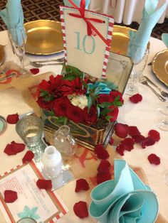Tiffany Blue and Red wedding . Floral arrangements were placed in antique tins.