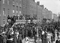 August 1, 1915 Funeral procession of Fenian Jeremiah O'Donovan Rossa. Trams drew to a halt and crowds lined the streets as the coffin passed. O'Rossa had died on Staten Island on 29 June 1915, but his body was brought back to Ireland for burial in Glasnevin Cemetery. This photo was taken at Parnell Square East, or Rutland Square East as it was then known