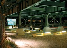 """(La Dallman's Urban Plaza """"converts an unsafe underbridge area into a civic gathering space for film festivals, regattas, and other river events"""" in Milwaukee, WI."""