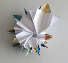 UnBound: A Paper Art Blog: Spiral Atlases: playing with The Road to Spring book structure by Gina Pisello