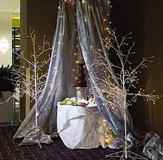 For extra beauty, place these Lighted Trees around your party room. The metal and plastic trees are each 7 feet high and lighted with over 280 twinkle lights.