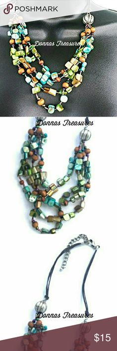 """Boho Chic Beaded Necklace This is a 4 strand necklace which measures 22.5"""" with the extender chain & 19"""" at the shortest length. It's made of an eclectic mix of beads secured by a sturdy lobster claw. Very lightweight & comfortable.  #0366 Jewelry Necklaces"""