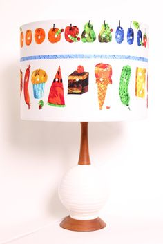 The very cute and iconic 'The Very Hungry Caterpillar' book by Eric Carle is now available as a lamp! The vibrant illustrations on the shade will brighten up any room. Great for a nursery lamp.    www.deargladys.com.au    *The price shown here is for the shade only. The base is not included.  This lamp shade can be used with a base or can be hung from the roof.