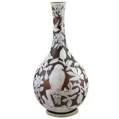 Important Thomas Webb & Sons Cameo Glass vase  England  circa 1900  An important Thomas Webb & Sons three color cameo glass vase carved with birds, flowers leaves and branches