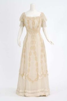 White silk mull dress trimmed with tan lace. Made by dressmaker Mary Molloy, St. Paul, Minnesota. Dates: Creation: 1898 - 1906