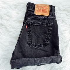 Black Levi's High Waisted Shorts Rare Vintage (faded black color) Levi's High Waisted Denim Shorts. These classic jean shorts are perfect for summer. Levi's are known for their long lasting high quality denim. They are rolled in the picture but you can cut them, distress them, sew them, or leave them rolled/cuffed. Add studs, patches, pins, fabric, or dye them for a unique look. Get creative! Plenty of DIY tutorials on YouTube to check out! Never worn. Great condition! Says size 6 so they…
