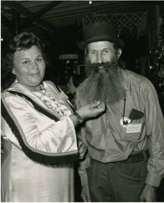 Edd Presnell shows off his beard with Mrs. Bill Crowe at the North Carolina State Fair. ^cs