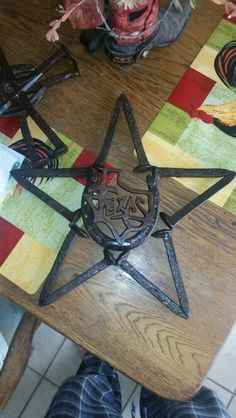 Star made from railroad spikes and horseshoe
