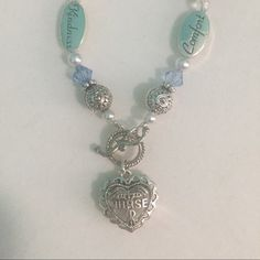 Nurse bracelet  Beautiful silver and blue bead nurse bracelet with toggle closure perfect gift for any new nurse!!! Never been worn!! Jewelry Bracelets