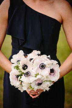 Pink  black:  unusual flowers brighten up a dark bridesmaids dress