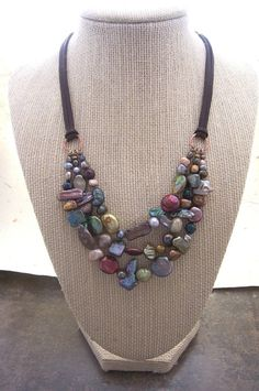 Hey, I found this really awesome Etsy listing at https://www.etsy.com/listing/123995016/multi-stranded-freshwater-pearl-necklace