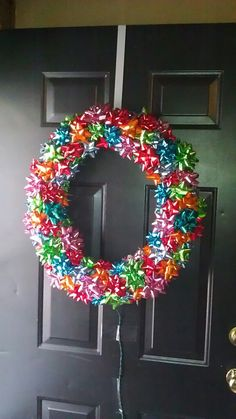 25 Really Awesome Christmas Front Door Decor Ideas - Adorable colorful bow wreath for front door decoration at Christmas. Front Door Christmas Decorations, Christmas Front Doors, Decorating With Christmas Lights, Holiday Wreaths, White Christmas Lights, Noel Christmas, Winter Christmas, Christmas Ornaments, Christmas Projects