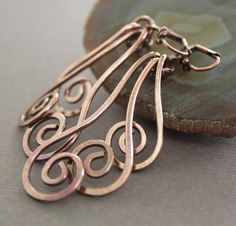 Swirl waves solid copper earrings  long dangle by IngoDesign, $24.00 I finally gave in and bought these earrings back at the beginning of April, and when they got here they were even MORE beautiful in person - just gorgeous and my new favorite pair!