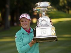 Brooke Henderson holds the KPMG Women's PGA Championship Trophy