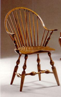A Continuous Arm Brace Back Windsor Armchair, Circa 1790, Branded W.  MACBRIDE /