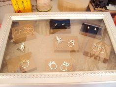 Use a frame to create a glass display case good idea for craft shows