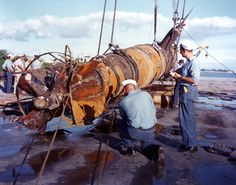 """""""Japanese Type A midget submarine photographed soon after its recovery near the entrance to Pearl Harbor, Hawaii, circa late July 1960. It had participated in the attack on Pearl Harbor on 7 December 1941, but had apparently been unable to enter the harbor as its torpedoes had not been fired."""" (NHHC: KN-2589)"""