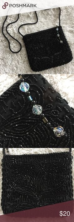Black Vintage Beaded Bag Beautiful beaded party purse! Silk cord shoulder strap makes this perfect for partying. Black satin interior. No beads loose, excellent condition. Perfect for prom or weddings. Bags