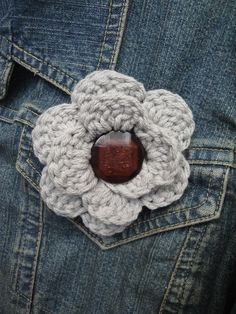 Crocheted flower pin... maybe use one of Grandma's old buttons...
