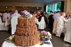 The most amazing wedding cake I've ever seen - belgium chocolate cake covered in flakes
