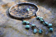 i adore dream catchers and roses. I can't think of anything better than joining them tgoether.