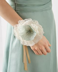 Lace Corsage    An organdy corsage looks beautiful with an added lace flower that was printed on heat transfer paper and then ironed on to fabric.  Make This Lace Corsage