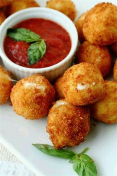 1 (8-ounce) container mini mozzarella cheese balls (bocconcini) 1 cup all-purpose flour 2 eggs, beaten 2 cups panko (Japanese breadcrumbs) 1 tablespoon chopped fresh flat-leaf parsley 1 tablespoon lemon zest Pinch of red pepper flakes Kosher salt and freshly ground pepper Marinara Cream Sauce: 1 cup red sauce 2 tablespoons heavy whipping cream Pinch of red pepper flakes