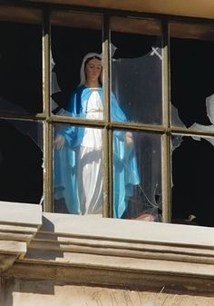 Mary statue in window of ruined Catholic Cathedral in Christchurch. Quake caused statue to turn around and look out at the city