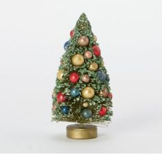 This tiny pine comes already decked in a sprinkling of bright metallic bulbs, for a ready-made touch of holiday cheer.- Wood, plastic, metal- Store in Holiday Sales, Holiday Fun, Holiday Decor, Holiday Ideas, Metal Store, Putz Houses, Bottle Brush Trees, Tis The Season, Happy Holidays