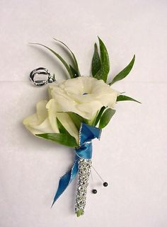 Prom or wedding Boutonniere with lisianthus, ruscus and blue ribbon with white rhinestone stem wrap.