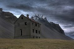 Abandoned farmhouse by the mountain Vestrahorn in the southeast of Iceland.